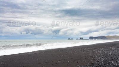 Reynisfjara Beach and view of Dyrholaey promontory