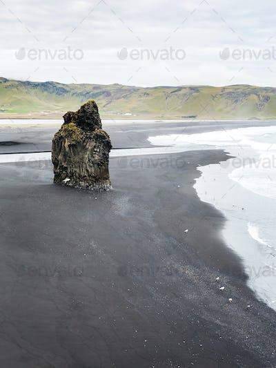 above view of volcanic stack on Kirkjufjara beach