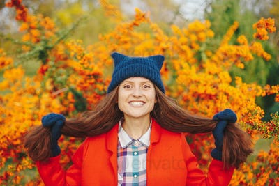 Model wearing stylish winter beanie hat and gloves smiling