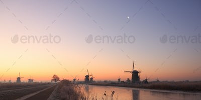 Colorful sunrise over the windmills of Kinderdyke