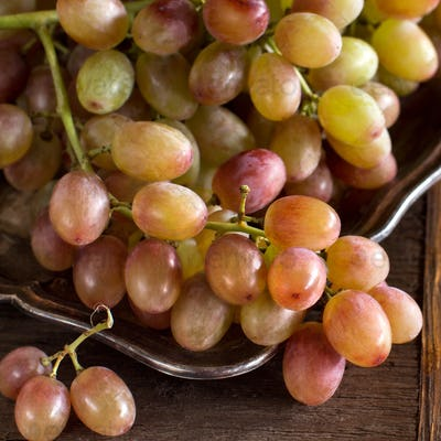 Grapes on silver tray on an  Wooden Background