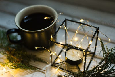 Christmas decor. Cup of coffee and candle
