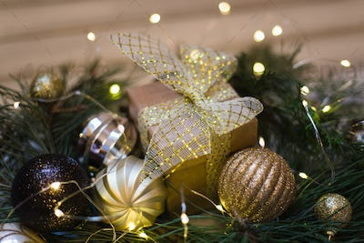 Christmas decoration with fir tree, gift box, garland lights, toys. Winter holidays.
