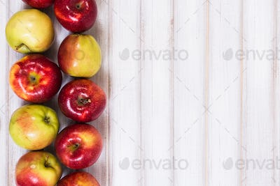 Sweet apples on wooden background