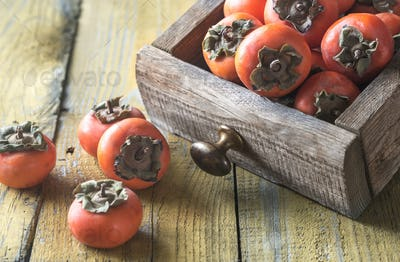 Wooden box of fresh persimmons