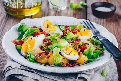 potato salad with eggs, lettuce,  tomatoes and bacon