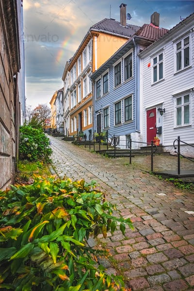 Narrow cobble stoned streets between traditional colorful houses