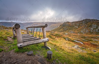 Small wooden bridge in the mountains