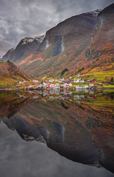 Small homes on the shore of a fjord