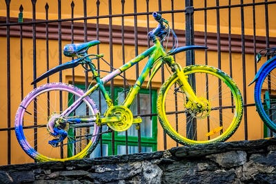 Old rusty colourfully painted vintage bicycle