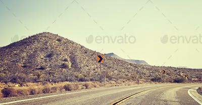Desert road turn, travel concept, USA.