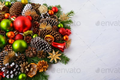 Christmas arrangement with red, green ornaments, straw stars, co