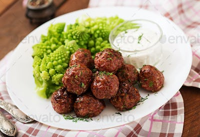 Baked beef meatballs and garnish from boiled cabbage romanesko. Dietary menu. Proper nutrition.
