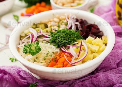 Beet salad Vinaigrette in a white bowl.