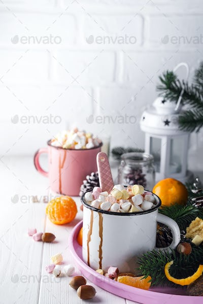 two cups with hot chocolate or cocoa with melted marshmallow