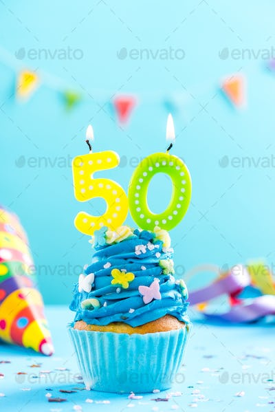 Fiftieth 50th birthday cupcake with candle. Card mockup.