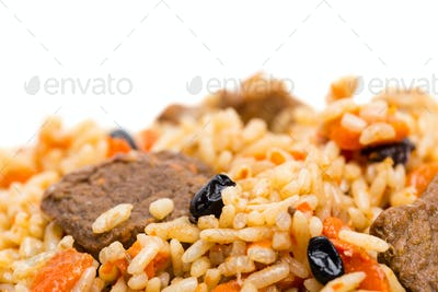 Fragrant pilaf with meat and dried apricots.