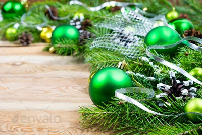 Christmas background with green baubles and silver ribbon