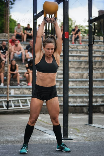 Cross training fitnes, female athlete with kettlebell