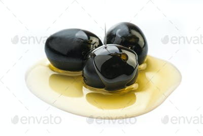 Black olives dipped in oil isolated on white