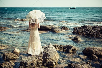 Beautiful young woman on the beach. Ocean