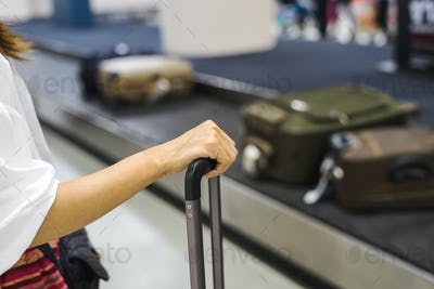 Passenger waiting Suitcase on luggage conveyor belt at the airport
