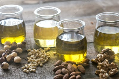 Glass jars with different kinds of nut oil