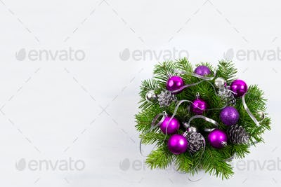 Christmas wreath with silver ribbon and purple baubles, copy spa