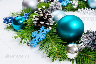 Christmas background with silver, blue and turquoise baubles
