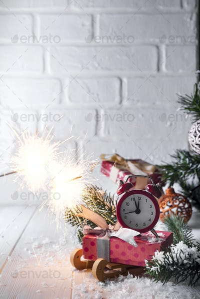 New Year's clock with burning Bengal fire