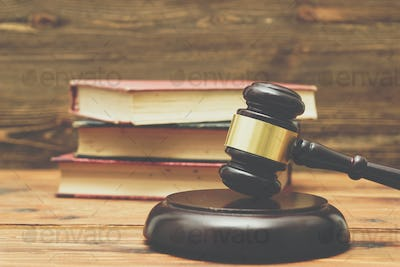 Gavel and law books on a wooden background