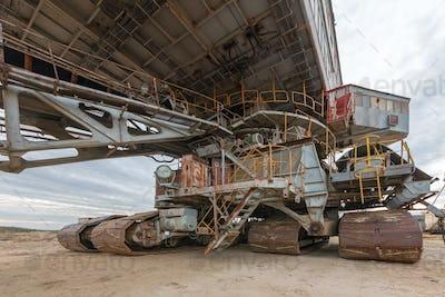 Cabin old broken rusty giant quarry excavator