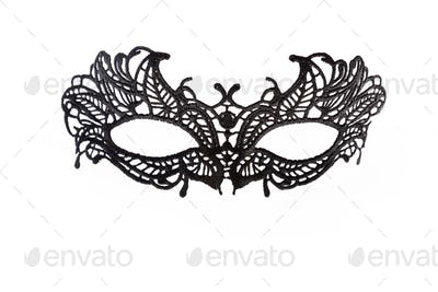 Black lace carnival mask isolated on white background