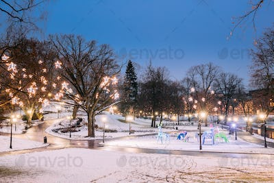 Riga, Latvia. Evening View Of Park Bastion Hill In Festive Chris