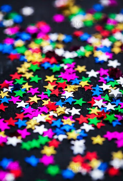 Multicolored holiday stars decoration background