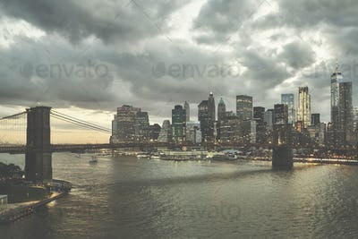 Retro stylized picture of Manhattan at dusk, USA.
