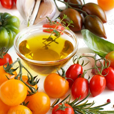 Colorful tomatoes, garlic, basil and oilve oil