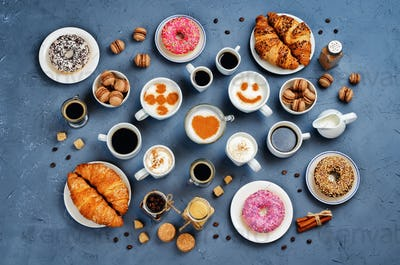 Stone background with different types of coffee and desserts to