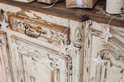 Christmas star and other decoration on ancient commode. Happy new year conception