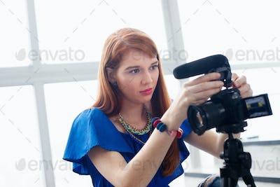 Woman Recording Vlog Video Blog Using DSLR Camera