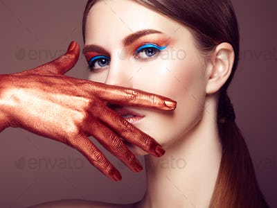 Portrait of beautiful young woman with art make-up