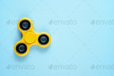 Fidget spinner toy on blue background