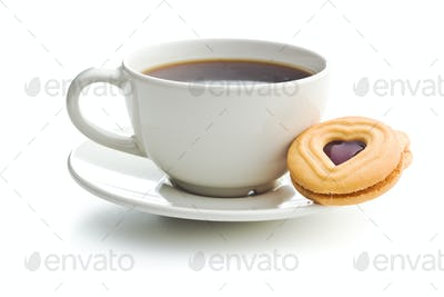 Sweet jelly cookies and coffee cup.