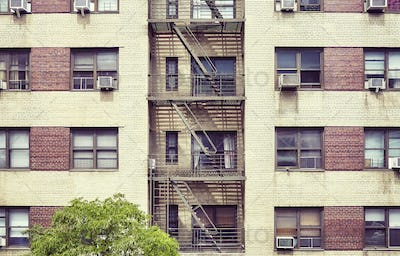 New York building with fire escape ladders, USA.