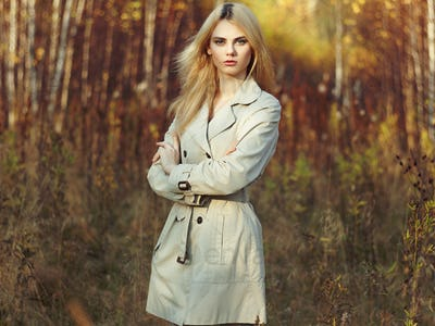 Portrait of young beautiful woman in autumn cloak