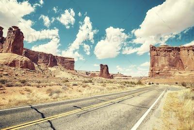 Retro toned picture of a scenic road, travel concept, USA.