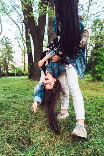 mom and daughter on the lawn have fun