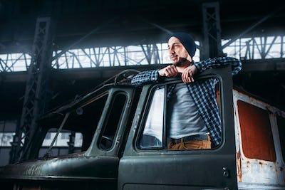 Stalker pose on abandoned military vehicle