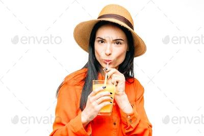 Woman drinks freshly squeezed orange juice