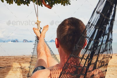 Man relaxing in the hammock